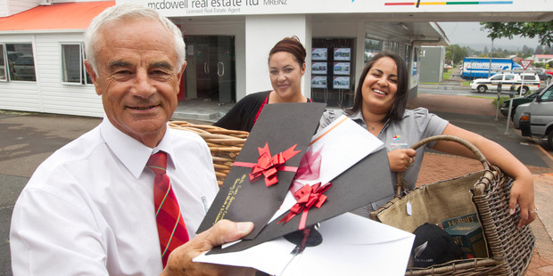 Ian McDowell (front) with Kellie Kanara-Batt (centre) and Aisha Okeremi with some of the items up for grabs. PHOTO/STEPHEN PARKER