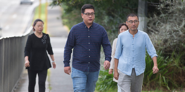 27-year-old Xingyu Shang (left, with dark shirt) arrives for his sentencing at the Manukau District Court, Auckland. Photo / Brett Phibbs