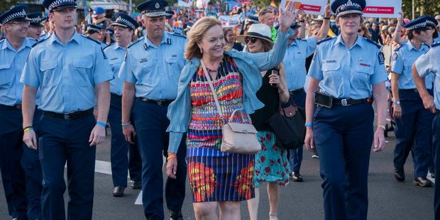 Judith Collins leads the police in the Pride Parade. Photo / Steven McNicholl