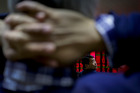 Stock markets in China will reopen following Lunar New Year holidays today and may be boosted following a strong close on Wall Street at the weekend. Photo / AP