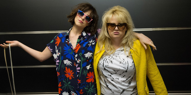 Dakota Johnson and Rebel Wilson in a scene from the film, How to Be Single.