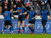 France's Maxime Medar, center, celebrates after he scores a try with his teammates during a Six Nations tournament Rugby match, France against Ireland. Photo / AP.