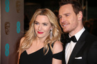 Kate Winslet and Michael Fassbender pose for photographers upon arrival at the BAFTA 2016 film awards at the Royal Opera House in London. Photo / AP
