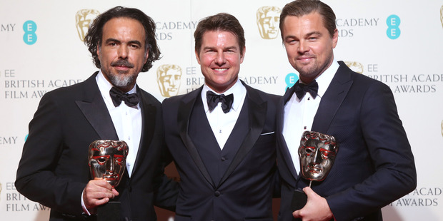 Director Alejandro Gonzalez Inarritu, left, actor Leonardo Di Caprio, right, with the Best Film and Best Actor award for the film The Revenant presented by actor Tom Cruise, centre. Photo / AP