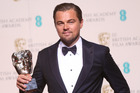Actor Leonardo Di Caprio with his Best Actor award for his role in the film The Revenant. Photo / AP