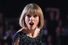 Taylor Swift performing at the 58th annual Grammy Awards. Photo / AP