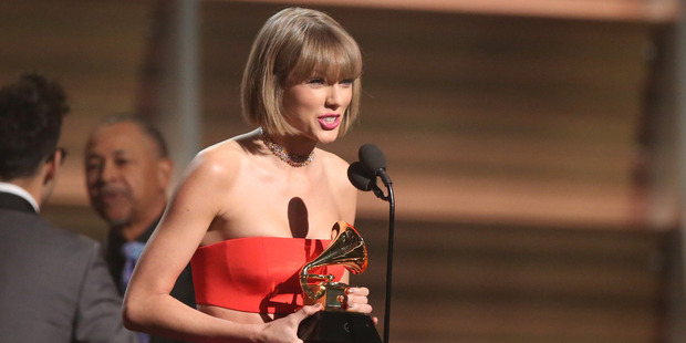Taylor Swift accepts the award for album of the year for 1989 at the 58th annual Grammy Awards. Photo / AP