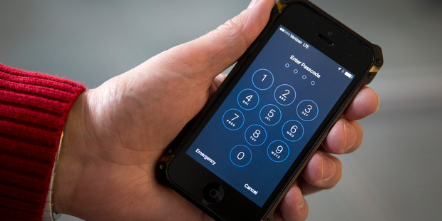 A U.S. magistrate judge ordered Apple to help the FBI break into a work-issued iPhone used by one of the two gunmen in the mass shooting at San Bernardino. Photo / AP