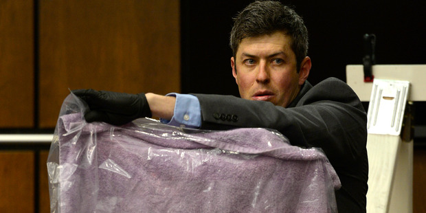 Longmont Det. Mark Deaton holds up evidence. Photo / AP