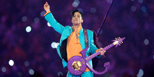 Prince performing on stage.