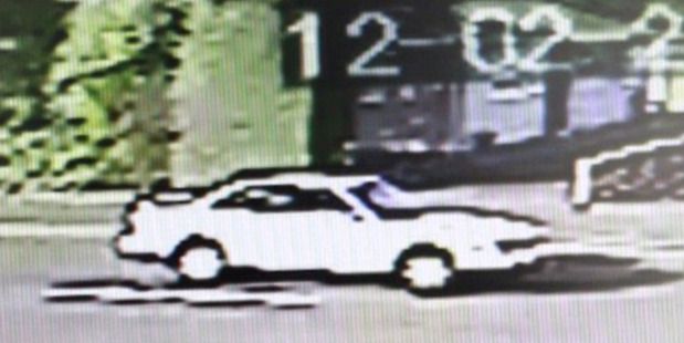 CCTV security video still of a white car on Shamrock St believed to have been driven by a man who tried to abduct a five-year-old girl. Photo / Supplied