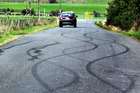 Skid marks from boy racers. Wanganui Chronicle Photograph by Stuart Munro