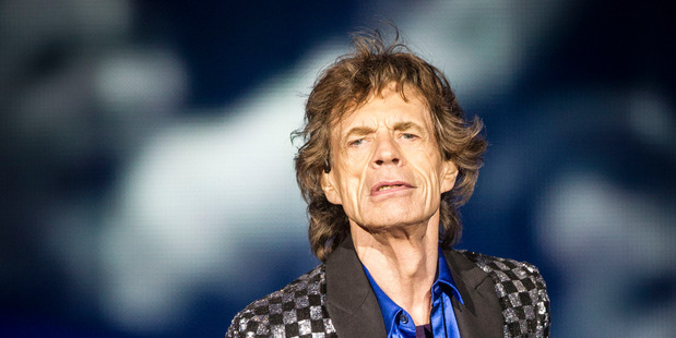 The Rolling Stones, including singer Mick Jagger are under armed guard, after a shooting at one of their shows.