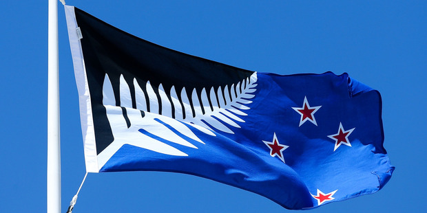 Silver Fern (Black, White and Blue), by Kyle Lockwood, flying on top of the Wellington Town Hall. Photo / Getty Images