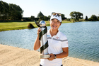 Lydia Ko poses with the New Zealand Women's Open trophy. Photo / Getty Images