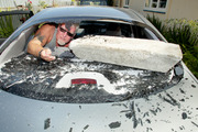 Andy Sinclair with a concrete block vandals used to smash the back window of his car last night. Hawke's Bay Today photograph by Warren Buckland