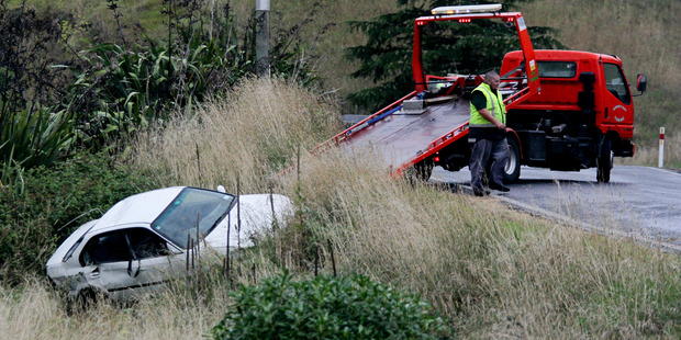 The car being pulled up from a bank on Puketitiri Road. Photo / Warren Buckland