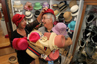 HATS ON: Shop manager Lynda Begley and one of the many devoted volunteers, Rick Kibblewhite, sort some of the fast-selling hats as the big Tremains Art Deco Festival kicks off. PHOTO/DUNCAN BROWN