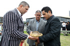 SPONSOR: Tremain Real Estate sponsor Simon Tremain, kaumatua Haami Hilton and George Reti, bless The Mauri Stone, from pa site Te Whanganui-a-Orutu at the powhiri. PHOTO/ DUNCAN BROWN