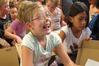 Ohaeawai School pupil Jessica Thomas, 8, from Kaikohe, reacts as she unpacks her Chromebook. Photo / Peter de Graaf