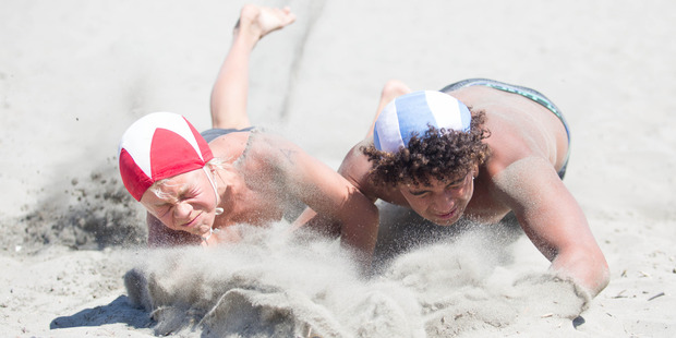 Omanu's Tanner Baxter edges Wainui's Sam Maso-Green to win the under-13 beach flags title at the Eastland Port Eastern Region junior surf lifesaving championships. Photo / Jamie Throughton/Dscribe Media