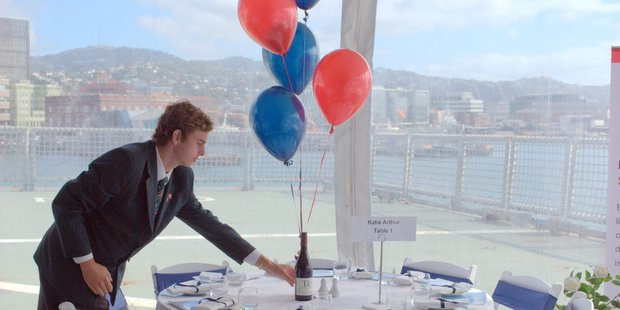Rathkeale College student Sam Wilkinson puts the finishing touches to a table with a view at the Fish & Ships charity event aboard HMNZS Canterbury last Friday. PHOTO/DALE WALTERHOUSE