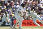 Tom Latham of New Zealand edges and is caught by Steve Smith of Australia. Photo / Getty Images.