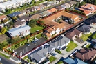 An aerial view of 31 unit former motel complex for sale at 252 Great North Rd, Henderson - identified by a red border.