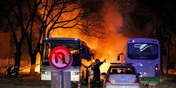 A police officer clears the area of the explosion in Ankara. Photo / AP