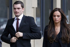 Former Sunderland and England player Adam Johnson arrives with partner Stacey Flounders at Bradford Crown Court. Photo / AP