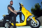 Joshua Whyman, from Hastings, has been reunited with his scooter which was stolen four years ago. Photo / Paul Taylor