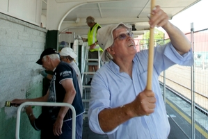 Graeme Mueller used the long roller for the top spots as he and his Hastings Host Lions colleagues spruced up the Hastings Railway Station building on Saturday.