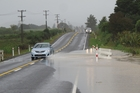 Surface flooding on State Highway 10 north of Pakaraka Junction. Photo / Peter de Graaf