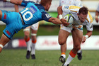 Aaron Cruden attempts to evade the attention of Ihaia West at Pukekohe. Photo / Getty