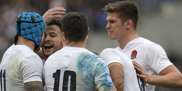 England's Jonathan Joseph, second right, is greeted by teammates after scoring his second try. Photo / AP