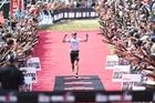 Cameron Brown celebrates his 11th Kellogg's Nutri-Grain Ironman New Zealand in Taupo last year. Photo / Delly Carr