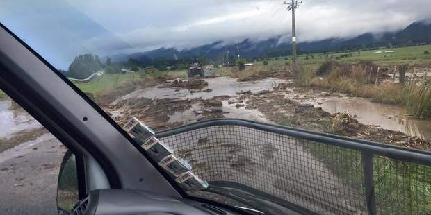 The road leading to the flooded house is completely washed out. Photo / Te Akauroa Miki