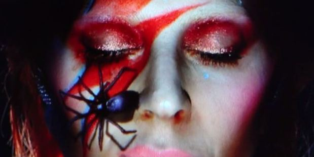 Visual effects during Gaga's tribute to David Bowie included signature lightening bolt and spider images.