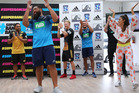 Blues Charlie Faumuina tries his dance moves with the ReQuest Dance Crew during the 2016 New Zealand Super Rugby Launch. Photo / Getty Images