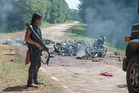 Daryl decimates Negan and his motorbike gang with a rocket launcher.