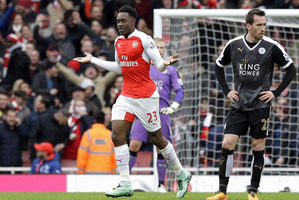 Arsenal's Danny Welbeck, left, walks past Leicester City's Christian Fuchs after scoring his side's second goal. Photo / AP