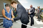 Deborah Grace, Partnership Advisory Group chairwoman, cuts the ribbon to the new mental health inpatient unit at Hawke's Bay Hospital with Jonathan Coleman, Health Minister. Photo / Warren Buckland