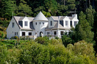 The house in Waitoki is styled like a French country chateau. Photo / supplied