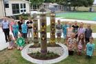 The centennial community art piece designed by principal Phil Missen (pictured back left).