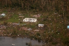 Debris is scattered around damaged buildings on the island of Vanua Balavu in southern Fiji. Photo / AP