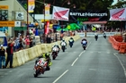 Whakatane's Tony Rees (Honda CBR1000RR, No11) takes the chequered flag to once more be crowned King of Paeroa. On the back page is Taupo's Scotty Moir about to take a corner. Photo / Andy McGechan/Bikesportnz.com