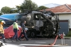 Police attend the scene of a burnt out milk tanker that collided with a car in Patea. Wanganui Chronicle Thursday, February 25, 2016 Wanganui Chronicle photograph by Bevan Conley.