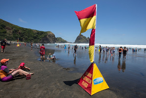 Swimmers enjoy the summer weather at Piha beach, on Auckland's west coast. Photo / Brett Phibbs