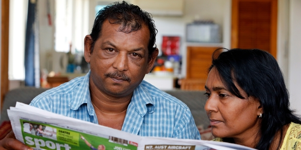 Rabendra Prasad and wife Suzy catch up with Fiji news through a Fijian newspaper. Photo / John Stone