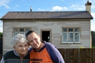 Sherrill Clayton-Reed, who mother died in a single-crewed ambualnce, and her friend Maureen Gallagher (left), outside Sherrill's late mother's house in Kaitangata. Photo / Otago Daily Times